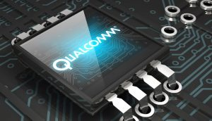 3d illustration of a glowing blue Qualcomm logo sitting on top of a glossy microchip
